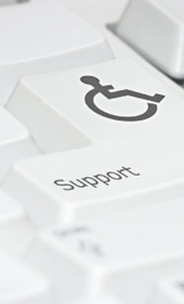 Image of a computer keyboard with standard disabled logo on a key