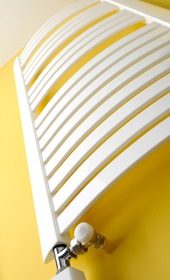 Designer radiator against yellow wall